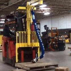 Fork lift mounted lift assist for lifting cartons and other products in a warehouse.
